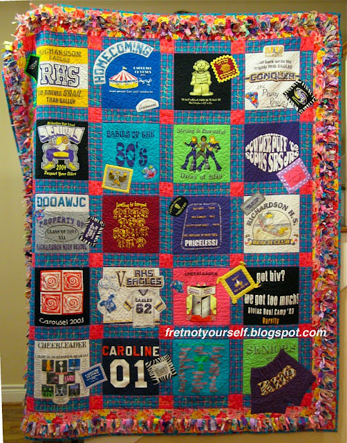 Twenty high school t-shirts are sashed with blue plaid and hot pink posts to make this quilt. The border is a confetti display of Texas Mink fringe.