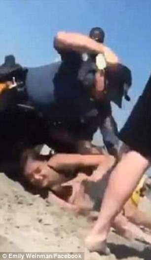 Viral video show Mom, 20, who was beaten by cops in front of her 18-month-old daughter on a New Jersey beach