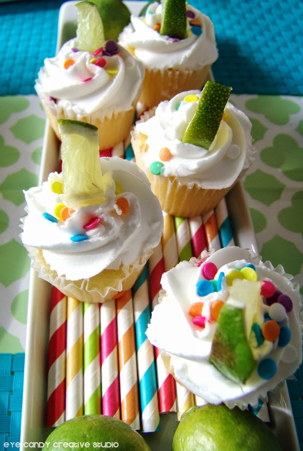 mini vanilla cupcakes, lime cupcakes, striped colored straws,sprinkles