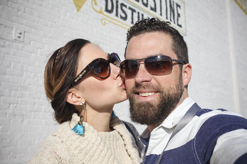 Amy West and David West take a selfie in front of the St Augustine Distillery