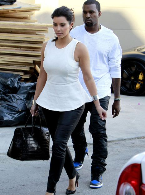 0f6adbe1a8f180 ... Kanye West Rockin Air Jordan 1 Black Royal Sneakers with the sexy Kim  Kardashian by his side. Looks Like Jordan Brand is beginning to hit these  celebs ...