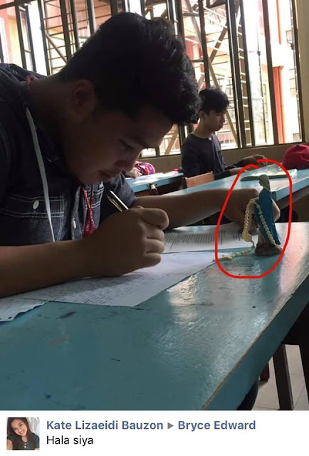This Student Went Viral for Taking An Exam With A Rosary and Mama Mary Statue In Tow!
