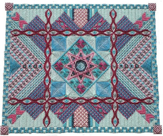 embroidered canvas with a variety of stitches and fibres that create texture