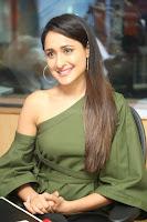 Pragya Jaiswal in a single Sleeves Off Shoulder Green Top Black Leggings promoting JJN Movie at Radio City 10.08.2017 005.JPG
