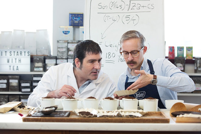 Academic James Hind (left) & Tetley Master Blender Sebastian Michaelis (right) examine the prefect blend