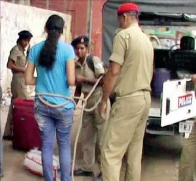 Video: Jharkhand police tie up Alwar girl in rope after arrest – her