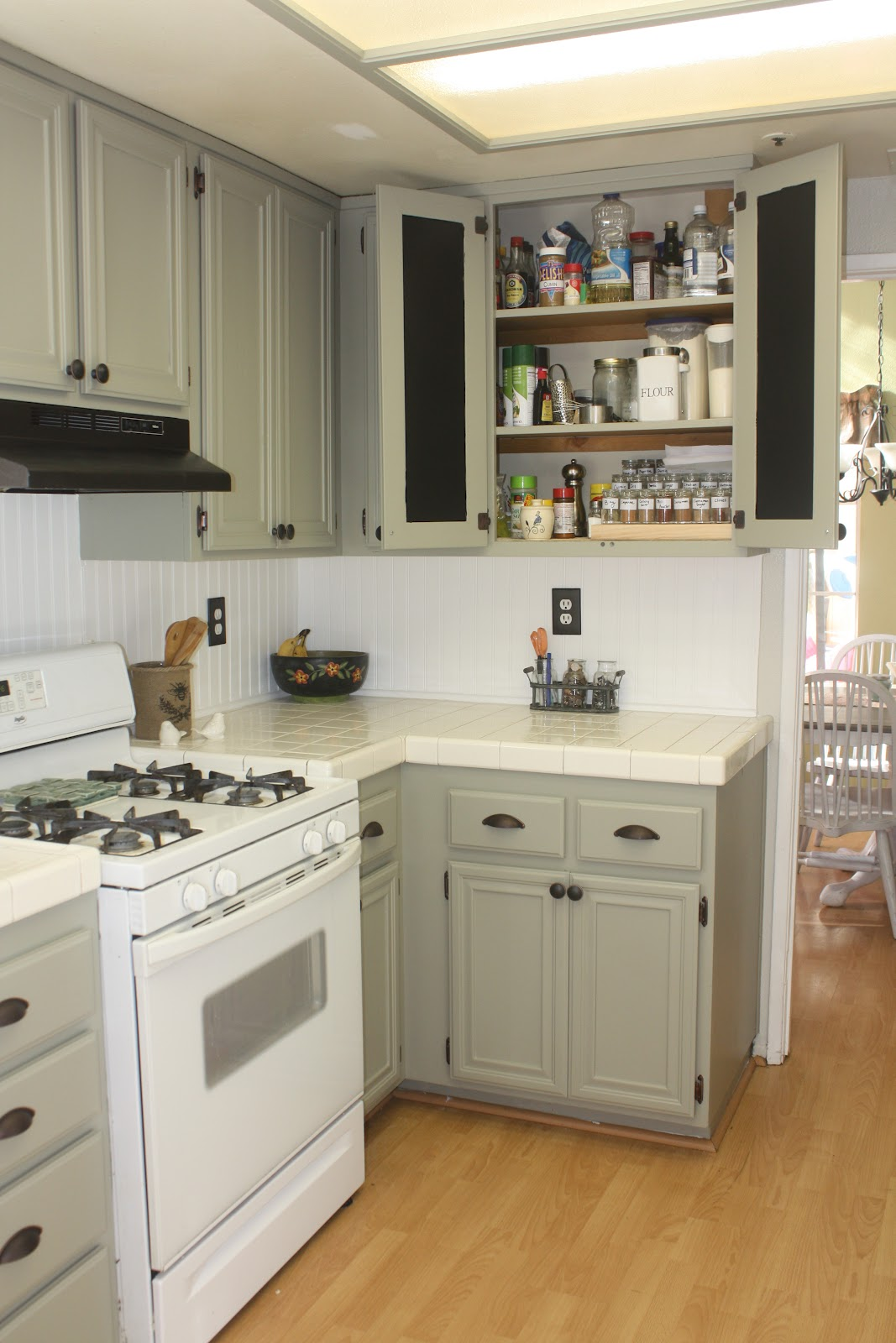 my new kitchen martha stewart kitchen cabinets Here is the price break down for our kitchen Wainscoting back splash 30 00 One sheet of wainscoting one tube of adhesive and we had to convert the