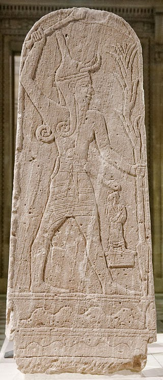 Stele of Baal with a club, wearing a conical headress, and holding the stem of a plant. Ugarit, c.1499-1299 BC.