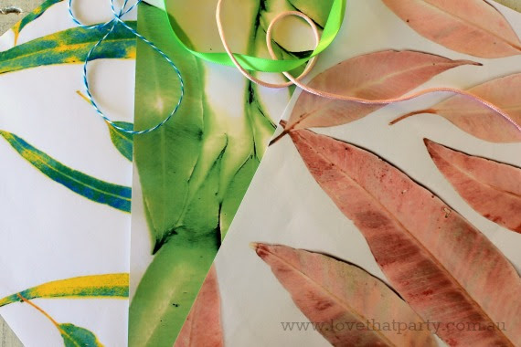 image of Australian foliage nature inspired gift wrap with gum leaves and twine