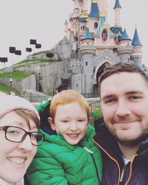 Mummy, Daddy and 3 year old son, standing close to the Disneyland Castle