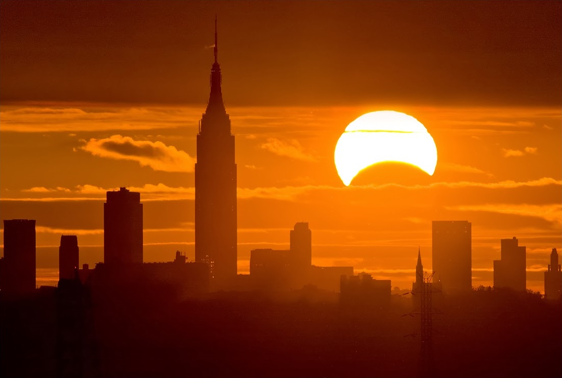 Solar Eclipse over New York City    New York City, New York, USA November 3, 2013  Image Credit & Copyright: Chris Cook