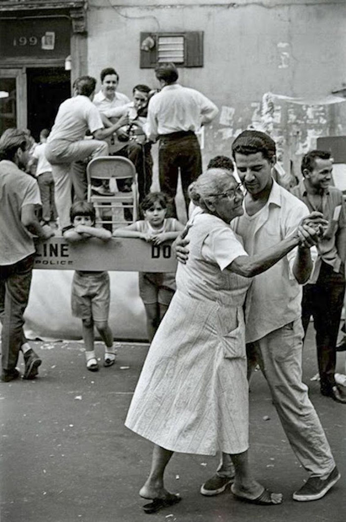 Grandma dancing in the street with her grandson. New York 1967 Photo by James Jowers