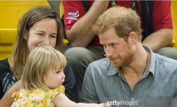 Prince Harry gives into sharing his popcorn