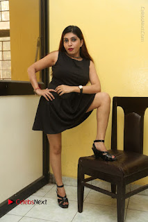 Tollywood Upcoming Actress Pooja Roshan Stills in Black Short Dress at Plus 1 Movie Trailer Launch  0183.JPG