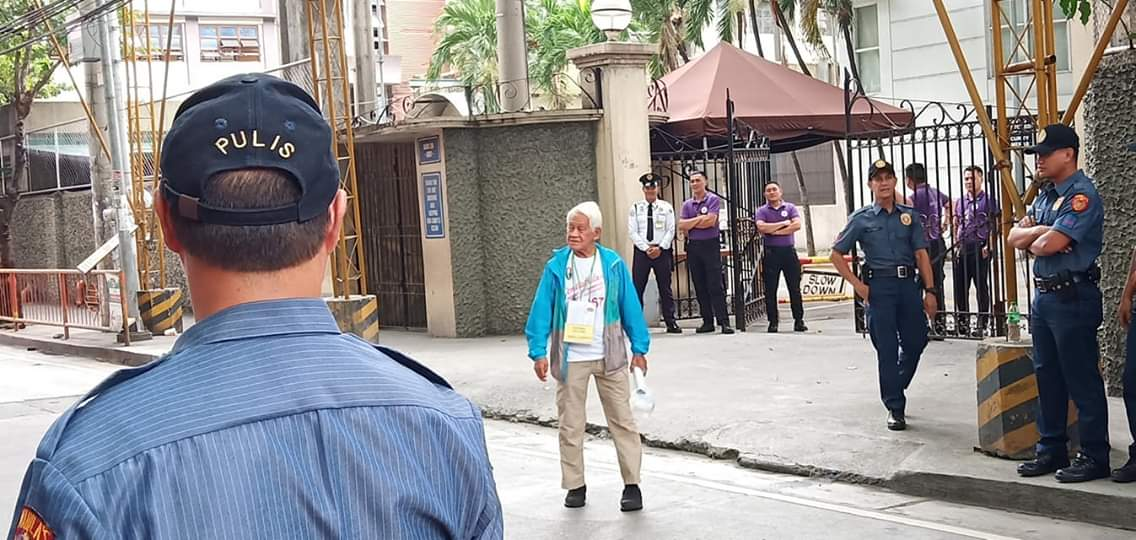 Retired Police Colonel Ibarra Mariano steps out of the University of Sto. Tomas