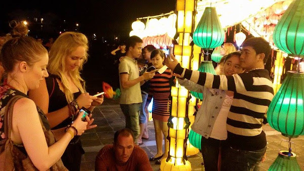 Tourists in the night market of Hoi An