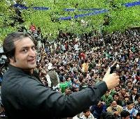 J&K People's Conference leader Sajjad Lone addressing party workers during an election campaign rally for his party candidate at Lalpora North Kashmir's Kupwara district. (PTI file Photo)