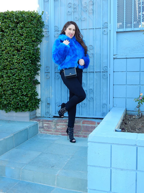 Marisa Stewart shows how to wear a faux fur jacket from Nordstroms with Jimmy Choo Booties and a Valentino Rockstud Bag