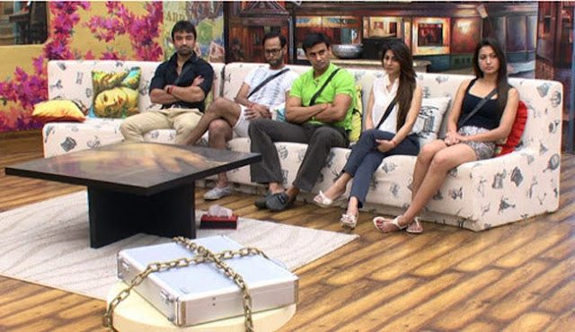 The final five Bigg Boss contestants thinking hard about the mysterious briefcase