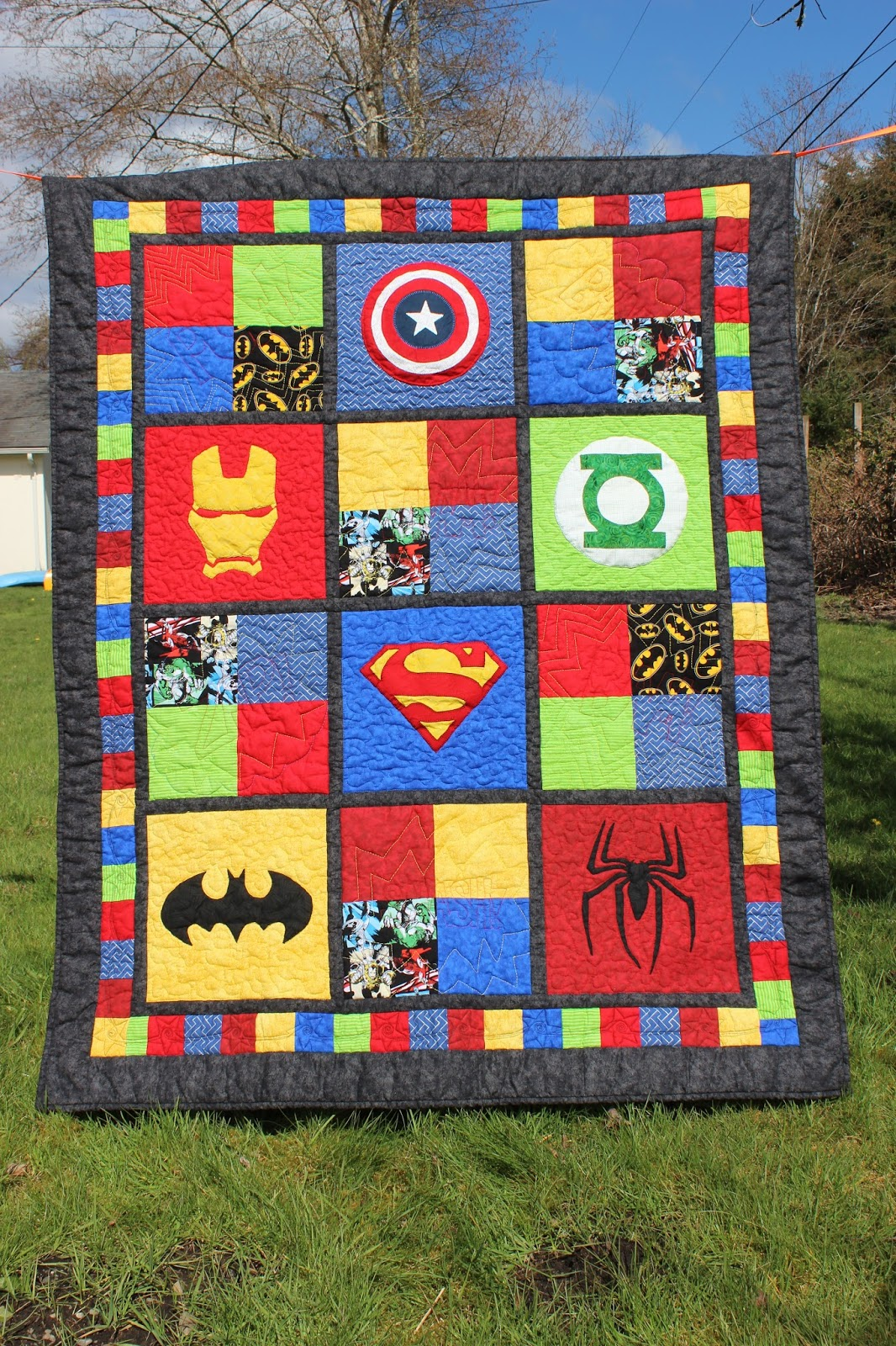 Puddle jumper quilts 39 n 39 things superhero baby quilt for Red door design quilts