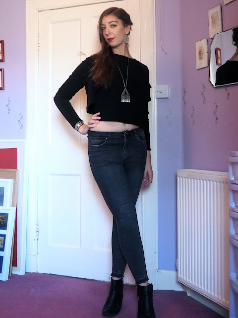 Back to Black | outfit of black shrug jacket & short top, grey skinny jeans & black heeled ankle boots