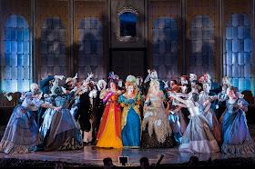 Heather Lowe as Tisbe, Fleur de Bray as Clorinda, Victoria Simmons as Angelina, Nicholas Lester as Dandini and the Opera Holland Park Chorus in La Cenerentola at Opera Holland Park. Photographer Robert Workman.