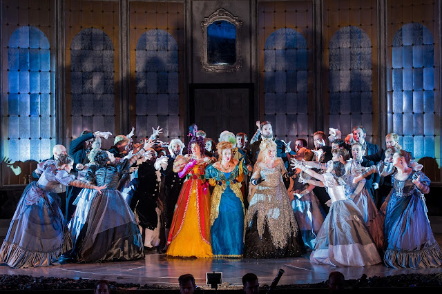 Heather Lowe as Tisbe, Fleur de Bray as Clorinda, Victoria Simmons as Angelina, Nicholas Lester as Dandini and the Opera Holland Park Chorus in La Cenerentola at Opera Holland Park. Photographer Robert Workman.