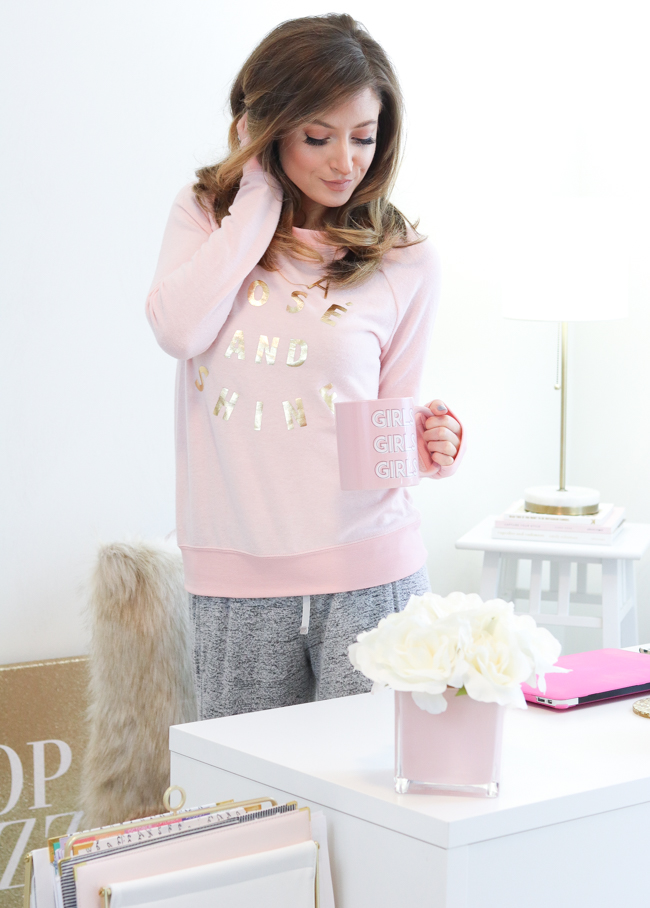 sitting at desk in target rose and shine sweatshirt