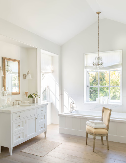 Elegant modern farmhouse style bathroom with white oak floors - found on Hello Lovely Studio