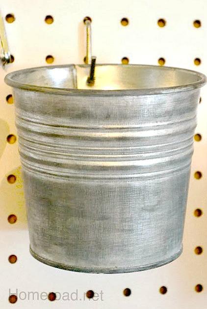 pegboard organization using buckets