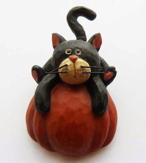 Cat on pumpkin brooch
