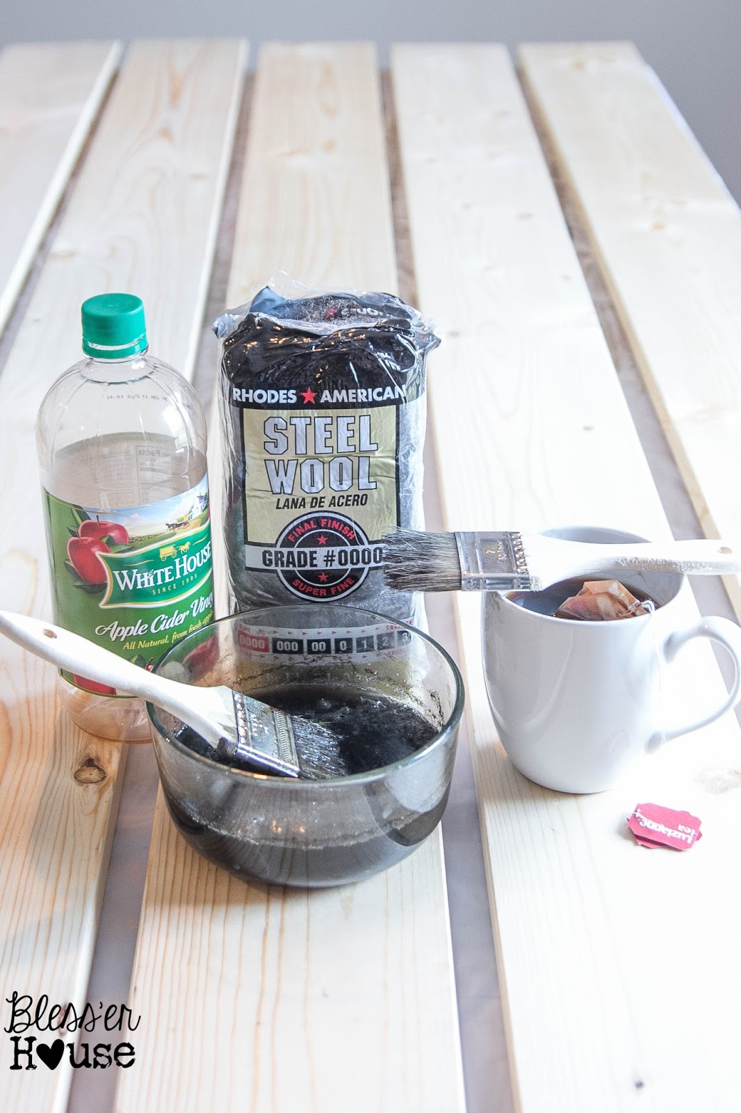 The ingredients you need for this DIY all natural wood stain method are steel wool pads, some black tea, apple cider vinegar and a few paint brushes.