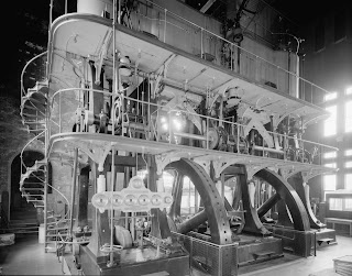 a complex mechanical engine in black and white