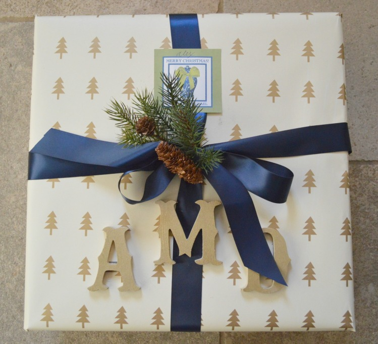 Beautiful cream, gold, and blue gift wrapped present by The Enchanted Home