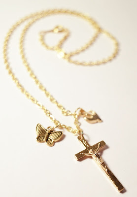 Chipina cross necklace with butterfly and dove