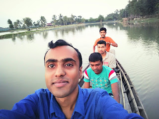 Sajal Mondal with his childhood friend during journey by Boat