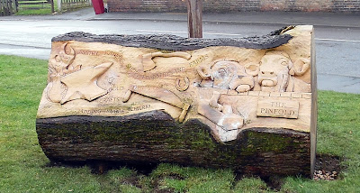 The new inscribed wooden totem outside Scawby Village Hall - February 2019