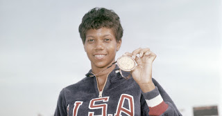 Wilma Rudolph holding medal