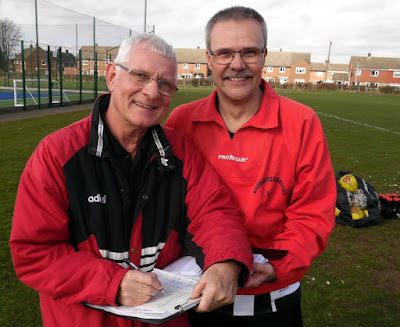 Footballer Colin Mumby, aged 69, signing up in Brigg to play for Briggensians in the Scunthorpe League, as Craig Benson looks on - February 2019