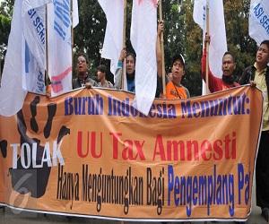 Foto demo buruh tolak tax amnesty