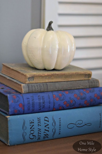 Blue Vintage Books with a White Pumpkin - One Mile Home Style Fall Home Tour