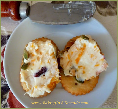 Thanksgiving Cheese Ball Appetizer: A make ahead cheese ball appetizer with all the flavors of fall. Easy and flavorful way to start your holiday meal. Serve with crackers, pretzels or crudites | Recipe developed by www.BakingInATornado.com | #appetizer #recipe #cheese
