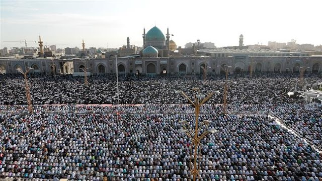 Millions of Iranians mark Eid al-Fitr with prayers to end of the holy fasting month of Ramadan