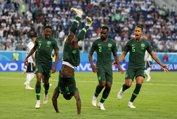 Victor Moses of Nigeria celebrates with teammates after scoring his team's first goal during the 2018 FIFA World Cup Russia group D match between Nigeria and Argentina at Saint Petersburg Stadium on June 26, 2018 in Saint Petersburg, Russia.