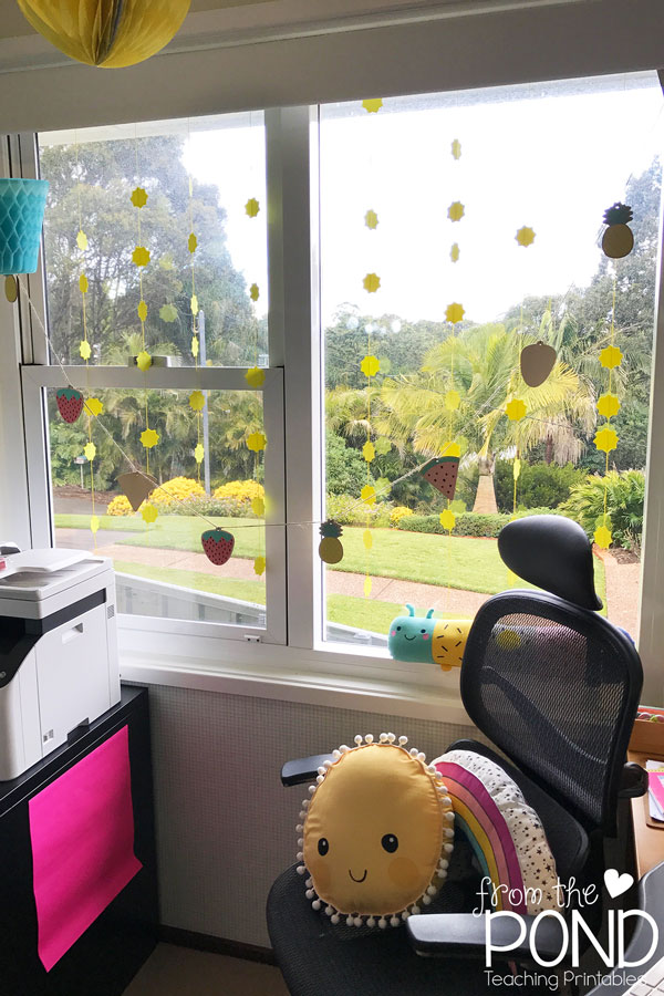 Sunshine mobile from paper suns hanging from window in home office