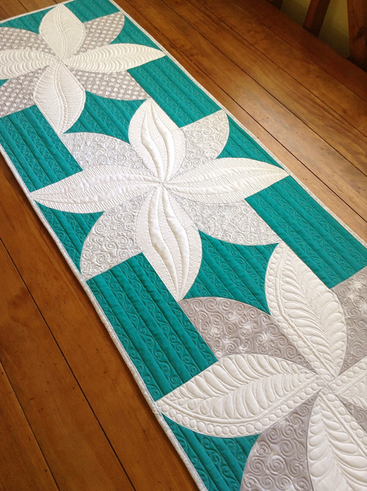 Fun Poinsettia Quilt Free Tutorial designed by Sew Kind of Wonderful