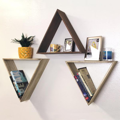 The Wooden Triangle Floating Wall Mount Shelf from Nile Corp can add a modern rustic vibe to your home