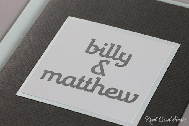 Charcoal gray, pocket folder, light blue, letterpress printing, interesting typography