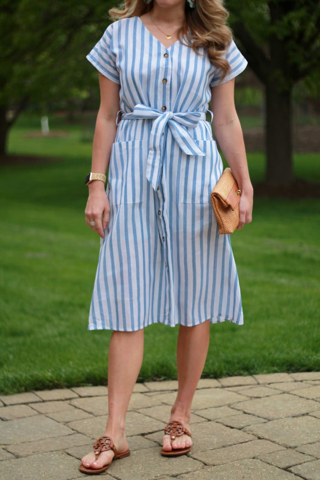 blue and white striped midi dress, tory burch miller sandals, straw clutch, multi color tassel earrings