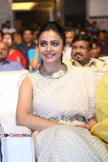 Actress Rakul Preet Singh Stills in White Dress at Winner Pre Release Function  0029.jpg